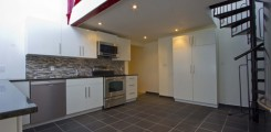Kitchen with Stainless Steel Range, Dishwasher, Microwave and Refrigerator